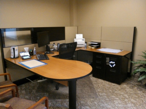 Startup utilizes used office furniture to save money and be fully functional.